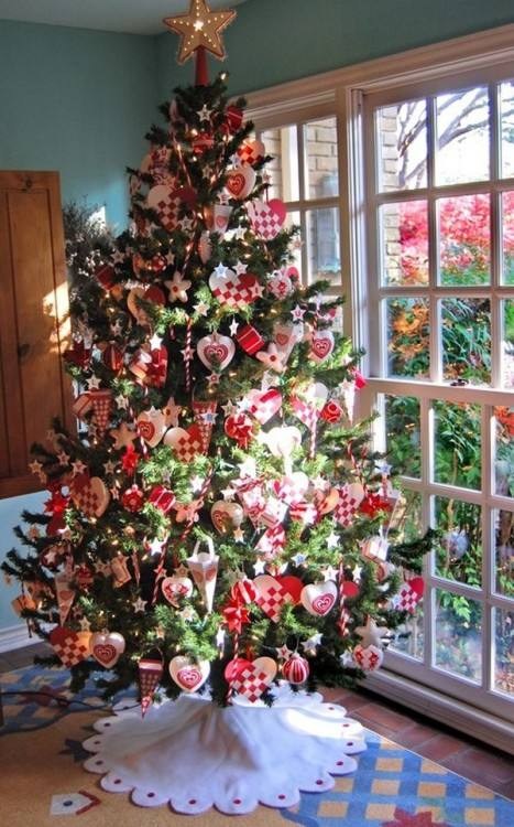 If you don't have enough floor space for a large Christmas tree, a small  metal spiral ornament tree with a matching star tree topper is a clever  option