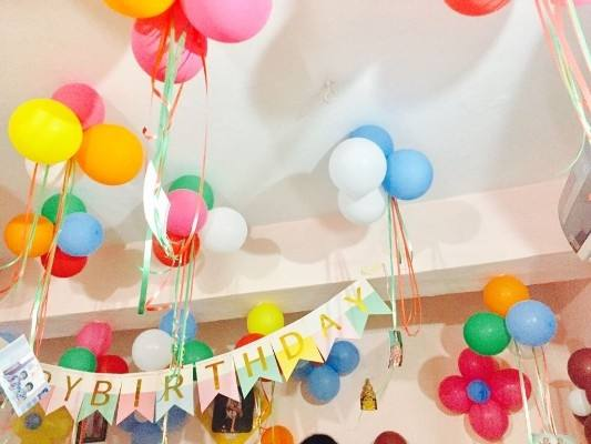 With party hats and pastel honeycomb decorations