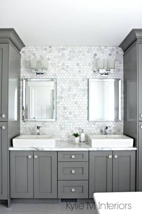 A look at the sink in the galley kitchen with a subway tile backsplash