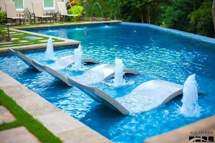 Create this whimsical display by tying weights to the end of your balloon strings + positioning them throughout the pool