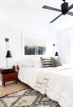 Vintage brown Moroccan rug in minimalist bedroom