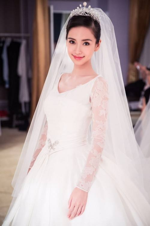 Angelababy's wedding dress was designed by Dior An image of Angelababy's wedding dress The Dior wedding dress took nearly five months to complete ENJOYED