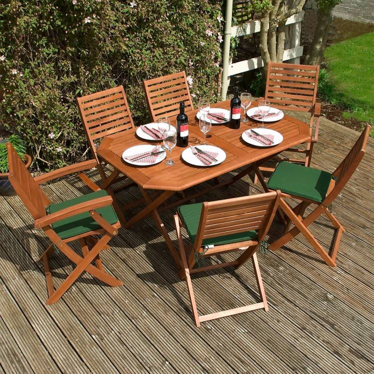 To get started on giving my outdoor dining furniture a complete makeover, I  gave everything a good cleaning and then used an electric sander to remove  the
