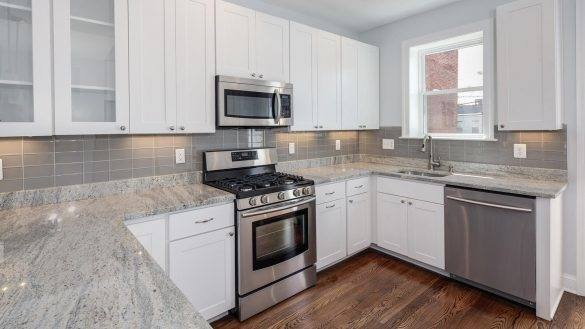 White kitchen cabinets are bright and cheerful