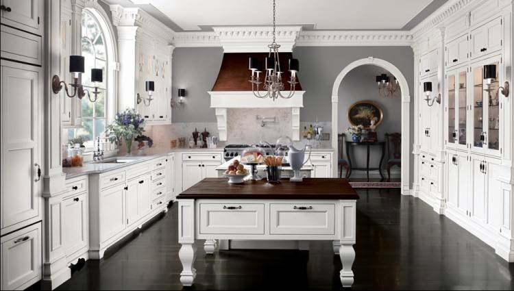 While few homeowners opt for the old opulent white kitchen all the way through, choosing white custom cabinets can offer you a very attractive, clean,