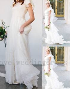 2017 Beach Bohemian Wedding Dresses Illusion Neckline Capped Sleeves Empire Backless White Lace And Chiffon Flowy Sexy Cheap Bridal Gowns Wedding Dresses
