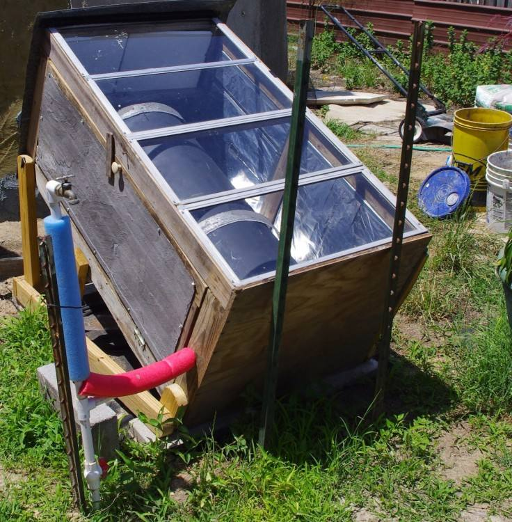 an outdoor shower with water that is heated from a solar water heater up  the hill