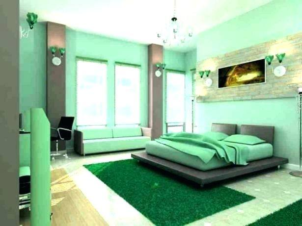 The master bedroom is painted in a soft forest green